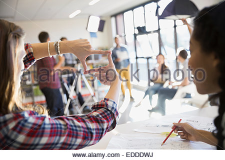 Business people shooting video tutorial - Stock Photo