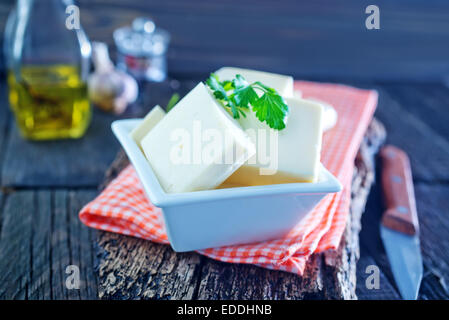 cheese in the bowl and on a table - Stock Photo