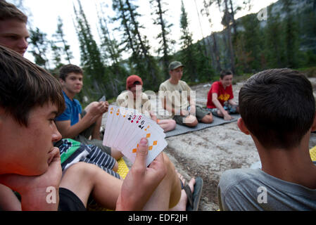 Payden Sternkopf checks his hand during a game of cards at camp at Douglas Lake on Day 3 of the troop's trek through - Stock Photo