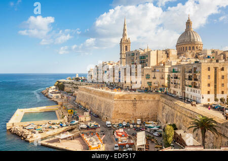 Valletta and Marsamxett Harbour with the Dome of the Carmelite Church and St Pauls Anglican Cathedral Valletta Malta - Stock Photo