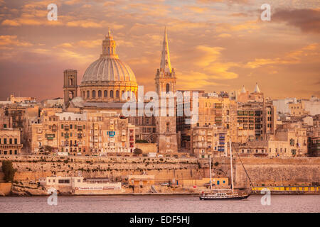 Valletta Skyline at Sunset with the Dome of the Carmelite Church and St Pauls Anglican Cathedral Valletta Malta - Stock Photo