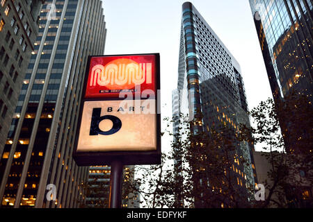 Lit sign at dusk for entrance to 'Bart' (Bay Area Rapid Transit ) on Market St. San Francisco California USA - Stock Photo
