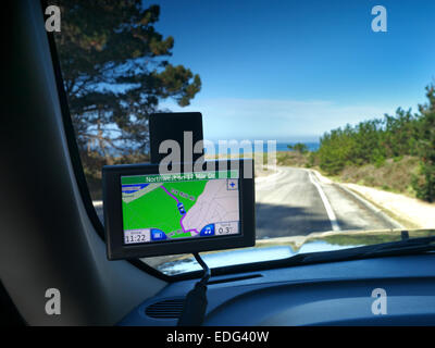 Satellite navigation screen in-car displaying 17 mile drive and Pacific Ocean at Pebble Beach Monterey California - Stock Photo