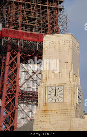 Art Deco Style clock tower with Blackpool Tower in background - Stock Photo