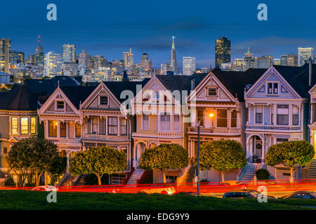 Night view of the Painted Ladies victorian houses in Alamo Square, San Francisco, California, USA - Stock Photo