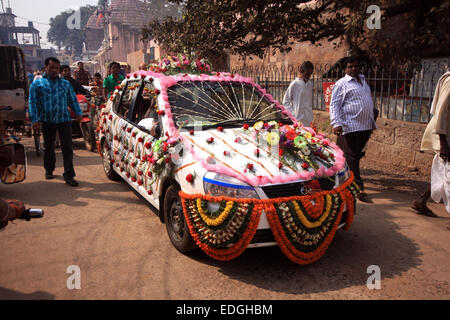 Wedding car decorated with flowers outside wedding venue for Auto decoration in pakistan