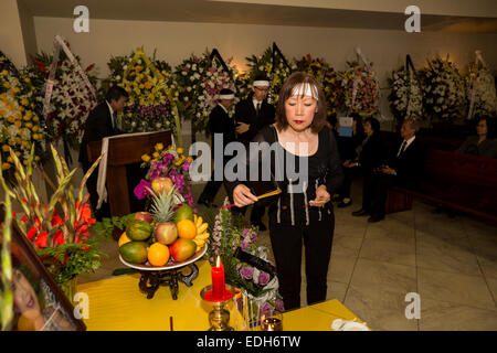 Family members, friends, mourners at Vietnamese funeral service, Little Saigon district, city of Westminster, California - Stock Photo