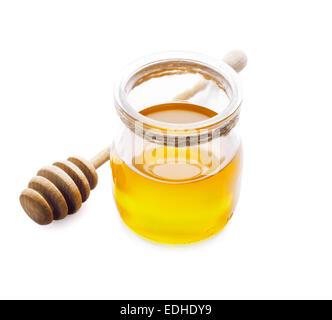 Sweet honey in glass jar on white background - Stock Photo