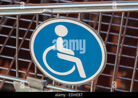 Wheelchair user disabled sign on a shopping cart /trolley extension for wheelchair users - Stock Photo