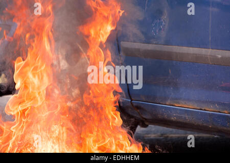 flames by a car fire stock photo