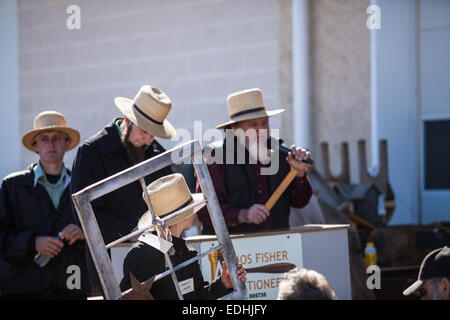 Amish at the annual Spring Mud Sale and  public auction in Gordonville, PA, which benefits the local fire company. - Stock Photo