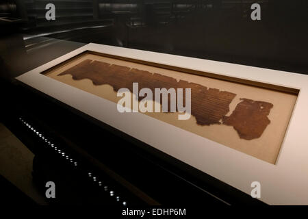 Ancient manuscript of Dead Sea Scrolls displayed in 'Shrine of the Book' or 'Hechal Hasefer' a wing of the Israel - Stock Photo