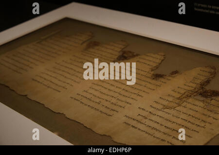 Ancient manuscript of Dead Sea Scrolls displayed inside the 'Shrine of the Book' or 'Hechal Hasefer' a wing of the - Stock Photo