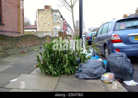 rubbish in street london bin bags fly tipping - Stock Photo