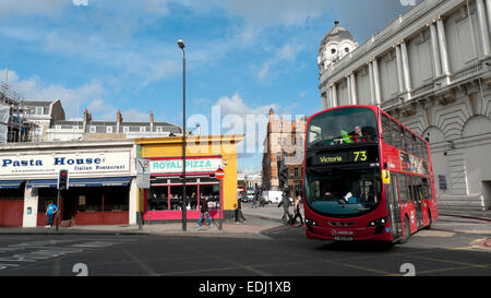 A double-decker 73 Victoria bus turns the corner at King's Cross Bridge and Grays in Road junction in London UK - Stock Photo