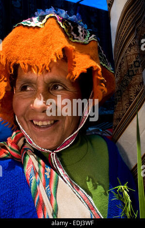 A woman dressed in a traditional costume in Pisac Sunday market day. Pisac. Sacred Valley. Pisac, or Pisaq in Quechua, - Stock Photo
