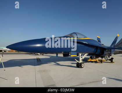 Modern navy fighter jet in blue color on the ground - Stock Photo