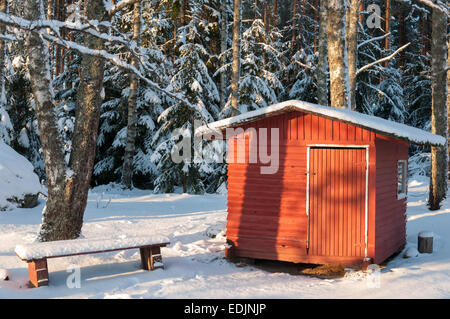 A child's Wendy house in winter. - Stock Photo