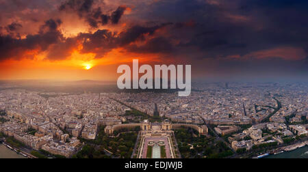 Sunset over Paris seen from top of Eiffel tower - Stock Photo