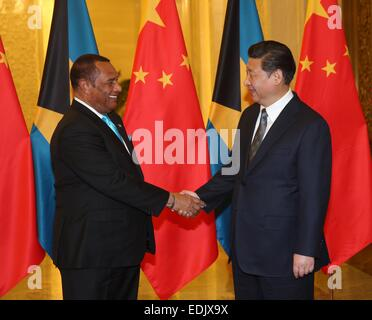 Beijing, China. 7th Jan, 2015. Chinese President Xi Jinping (R) meets with Bahamas Prime Minister Perry Christie - Stock Photo