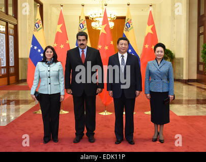 Beijing, China. 7th Jan, 2015. Chinese President Xi Jinping (2nd R) and his wife Peng Liyuan (1st R) pose for photo - Stock Photo