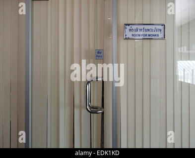 Sign waiting room for monks only at Suvarnabhumi airport Bangkok. Thailand. Southeast Asia. - Stock Photo