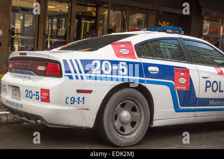 A police car with stickers protesting against bill 3 is pictured in Montreal - Stock Photo