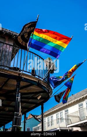 LGBT Flags fly outside a bar in the French Quarter of New Orleans LA - Stock Photo