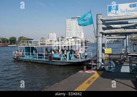 Cross River Ferry arriving at the Oriental Pier Chao Phraya River Bangkok - Stock Photo