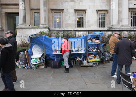 Trafalgar Square, London, UK. 7th January 2015. Squatters evicted from the bank near Trafalgar Square have set up - Stock Photo
