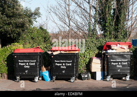 Paper and card recycling bins stood on a pavement in Margate. - Stock Photo