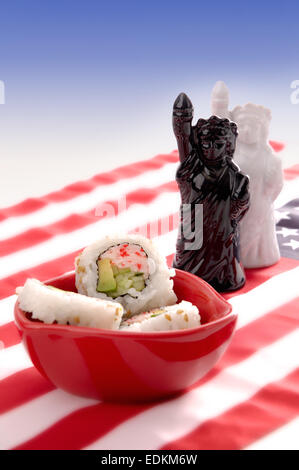 Sushi on American flag with Statue of Liberty novelty salt and pepper shakers. - Stock Photo