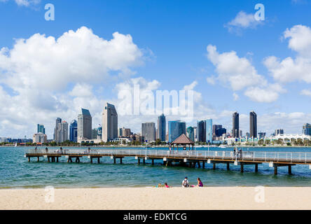 Family on the beach on Coronado Island with the downtown San Diego skyline across the bay, San Diego, California, - Stock Photo