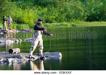 Fly fisherman standing on a rock casting his fly rod for Oregon free fishing day 2017