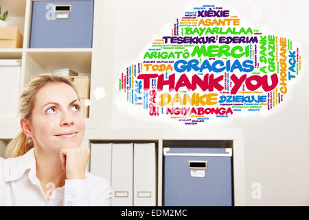 Woman in office thinking about thank you in many different languages - Stock Photo