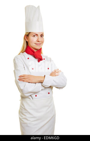 Woman as chef cook in apprenticeship with chef's head and workwear - Stock Photo