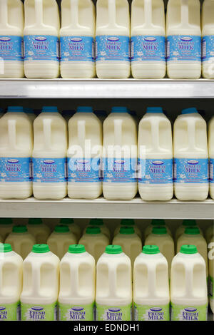 fresh milk and low fat milk on a shelf in a supermarket, Ireland - Stock Photo