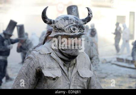 Man wearing viking helmet, Els Enfarinats flour fight, rebels, armed with flour, eggs and firecrackers, take over - Stock Photo