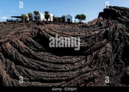 House on a lava field, near Tahiche, Lanzarote, Canary Islands, Spain - Stock Photo