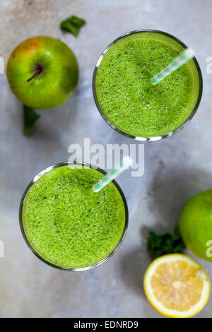 Green smoothies with kale and apples - Stock Photo