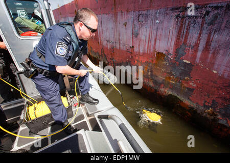 US Customs and Border Protection Officer checks a ship below the water at the Port of Philadelphia using a robotic - Stock Photo