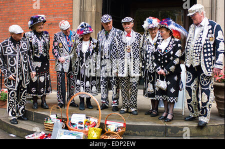A large group of Pearly Kings and Queens from gather for the Harvest Festival Service at St. Paul's Church in Covent - Stock Photo
