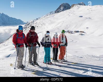 Family of skiers ski on Tete de Balme in French Alps. Le Tour, Chamonix-Mont-Blanc, Haute Savoie, Rhone-Alpes, France, - Stock Photo