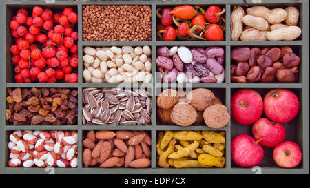 various vegetarian healthy fruits, seeds and dried food ingredient  in wooden box - Stock Photo