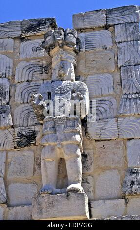 Detailed carving of Gods on Mayan ruins in Mexico - Stock Photo