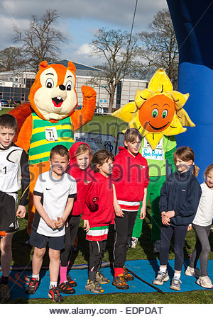 Mascots and children at the start of the Children's race . Keighley BigK 10K run West Yorkshire England UK - Stock Photo