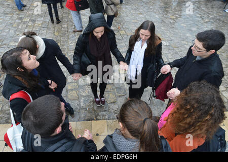 Paris, France. 8th Jan, 2015. People gather for a minute of silence for the victims of the January 7 attack against - Stock Photo