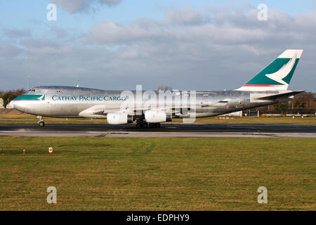 Cathay Pacific Cargo Boeing 747-400 accelerates down runway 23R at Manchester airport. - Stock Photo