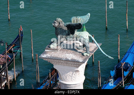 Bronze statue of winged Lion symbolising St Mark the Evangelist on column in piazzetta Venice Italy which dates - Stock Photo