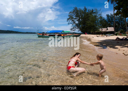 Beach on the island of Koh Russei. Cambodia. Travel with children's. Mother playing with her daughter. Koh Russei, - Stock Photo